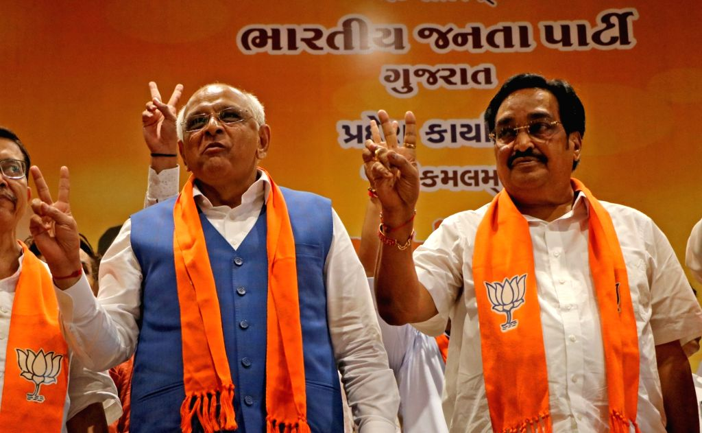 Gujarat Chief Minister Bhupendra Patel with State BJP President C R Patil after winning Gandhinagar Municipal Election at BJP headquarter in Gandhinagar on Tuesday October 05,2021,(PHOTO:Siddharaj ... - Bhupendra Patel and C R Patil
