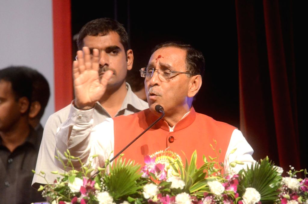 Gujarat Chief Minister Vijay Rupani addresses during a business conference in Mumbai on July 2, 2017. - Vijay Rupani