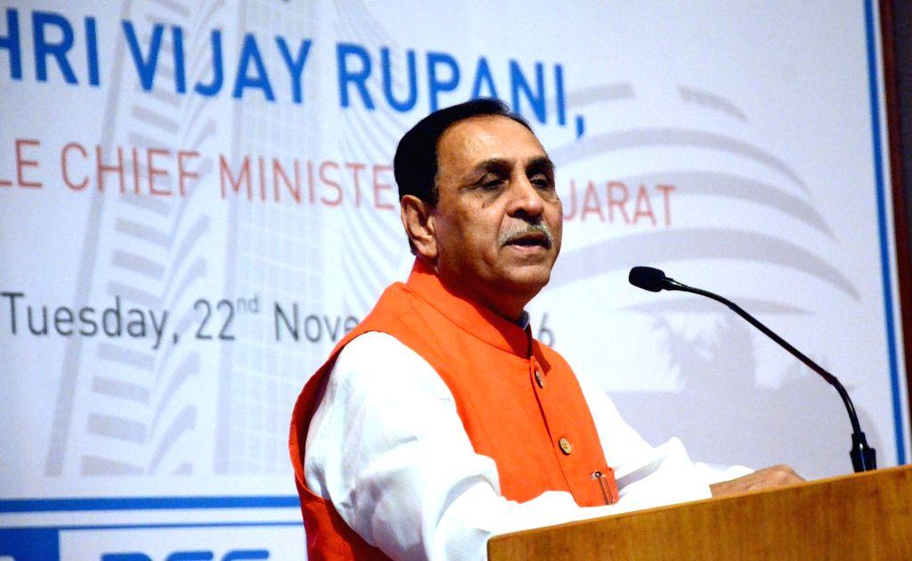 Gujarat Chief Minister Vijay Rupani addresses at Bombay Stock Exchange (BSE) in Mumbai on Nov 22, 2016. - Vijay Rupani