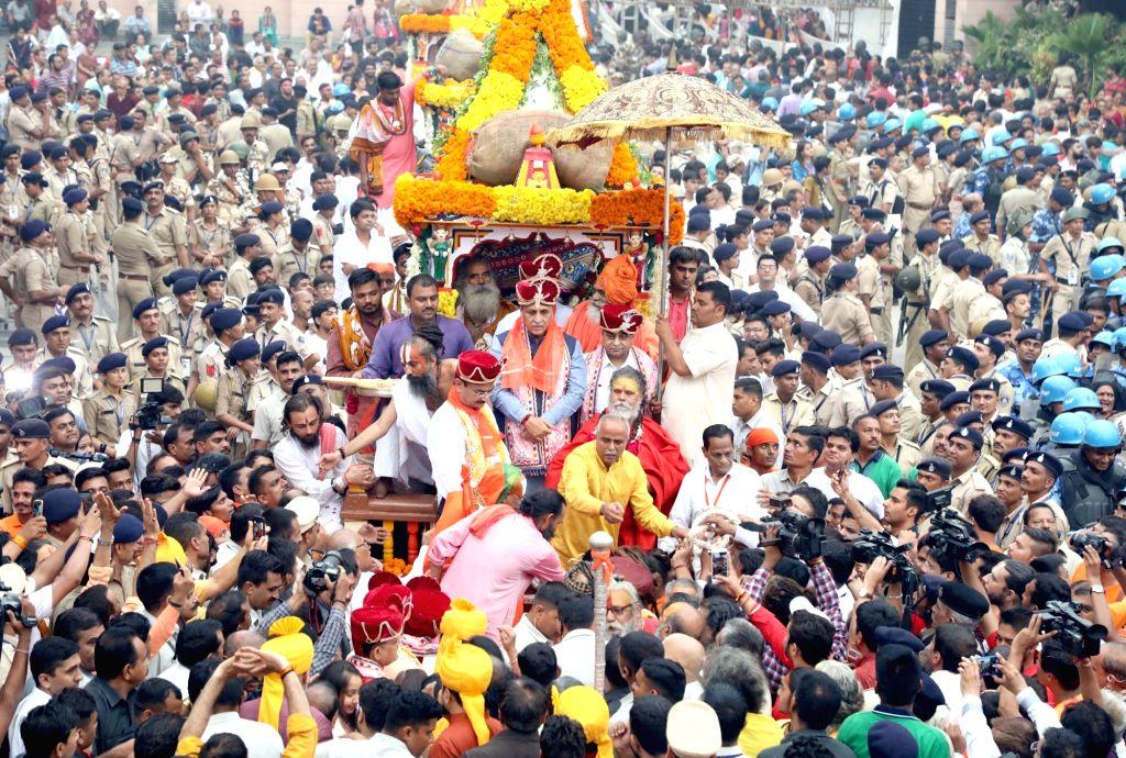 Gujarat Chief Minister Vijay Rupani and Deputy Chief Minister Nitinbhai Patel participate in the traditional 141st Rath Yatra of Lord Jagannath, in Gujarat's Jamalpur on July 14, 2018. - Vijay Rupani and Nitinbhai Patel