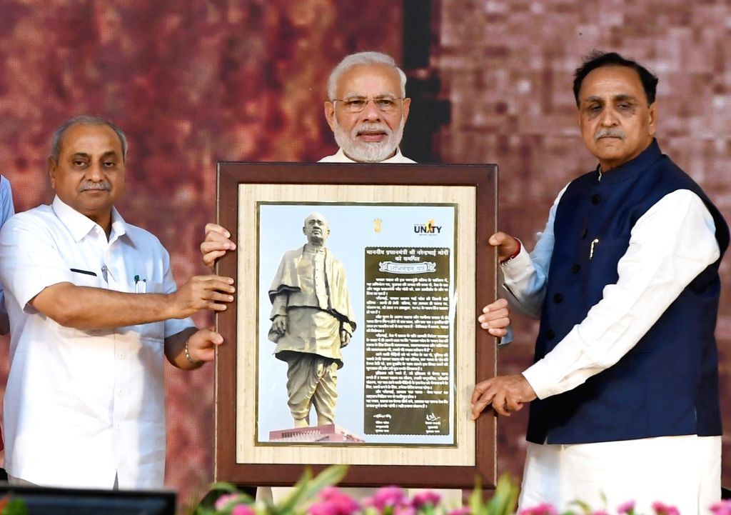 Gujarat Chief Minister Vijay Rupani and Deputy Chief Minister Nitin Patel felicitate Prime Minister Narendra Modi at the inauguration of 'Statue of Unity' on the occasion of Rashtriya ... - Vijay Rupani, Narendra Modi, Nitin Patel and Sardar Vallabhbhai Patel