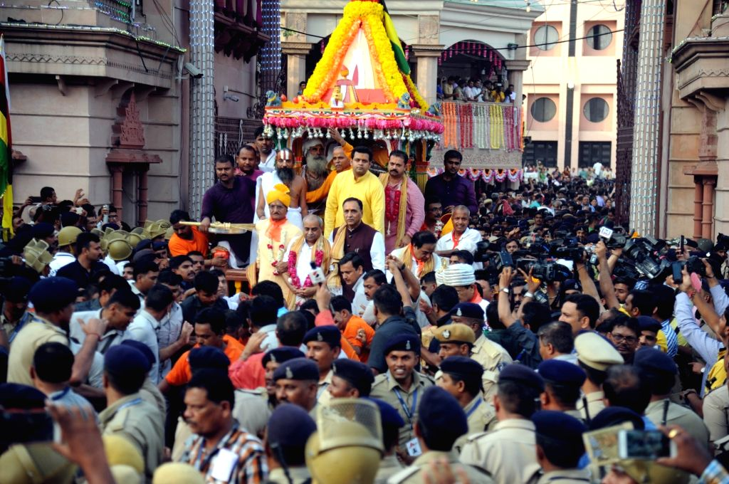 Gujarat Chief Minister Vijay Rupani and Gujarat Deputy Chief Minister Nitin Patel participate in Rath Yatra in Ahmedabad on June 25, 2017. - Vijay Rupani and Nitin Patel