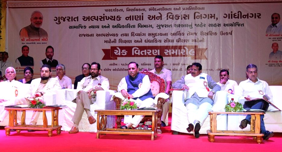 Gujarat Chief Minister Vijay Rupani and Union MoS Minority Affairs Mukhtar Abbas Naqvi at the cheque distribution programme of GMDFC in Gandhinagar on Aug 19, 2017. - Vijay Rupani
