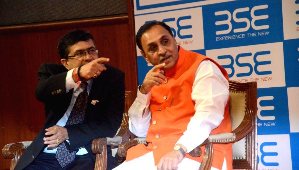 Gujarat Chief Minister Vijay Rupani at Bombay Stock Exchange (BSE) in Mumbai on Nov 22, 2016. Also seen BSE CEO Ashish Kumar Chauhan - Vijay Rupani and Ashish Kumar Chauhan