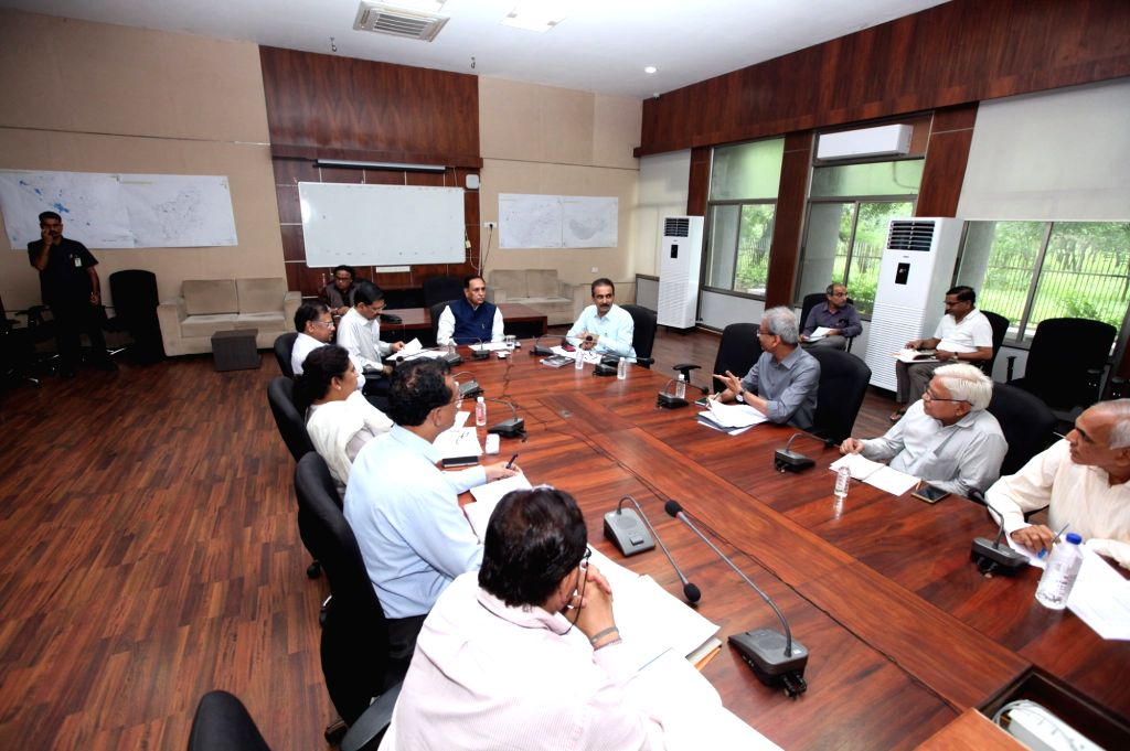 Gujarat Chief Minister Vijay Rupani chairs a meeting to review flood situation in the state, in Gandhinagar on Aug 10, 2019. - Vijay Rupani