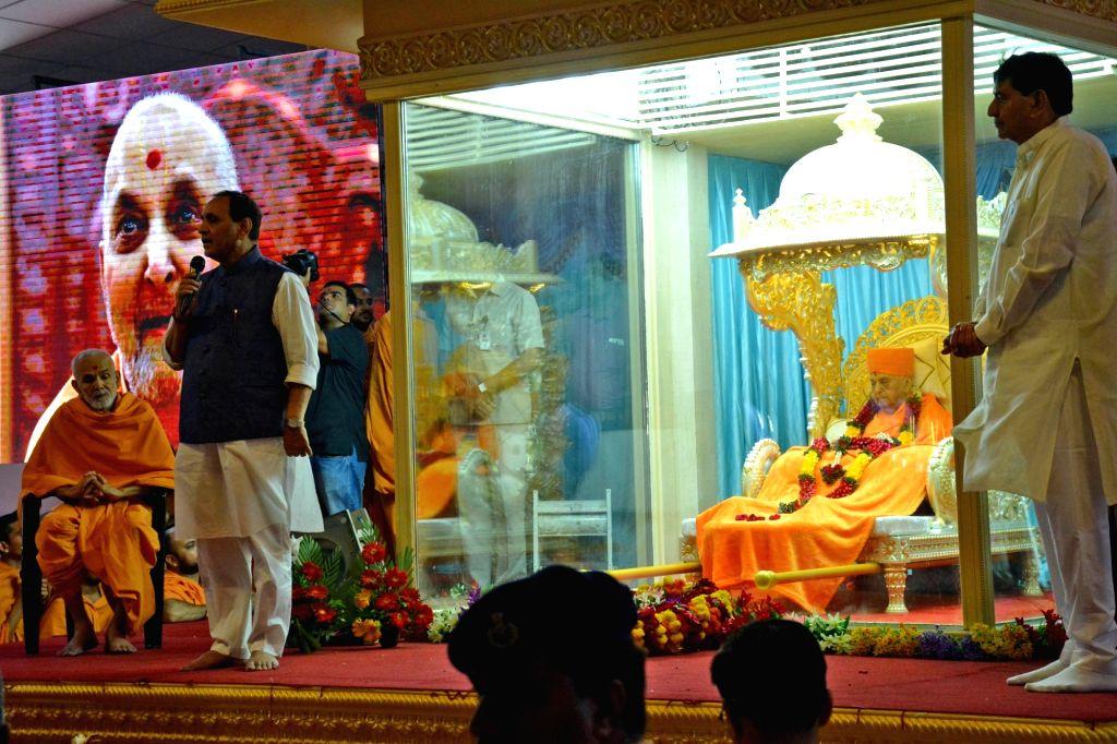 Gujarat Chief Minister Vijay Rupani during a programme organised to pay tribute to Swaminarayan Sect Pramukh Swami Maharaj at BAPS Shri Swaminarayan Mandir near Botad in Gujarat on Aug 14, ... - Vijay Rupani
