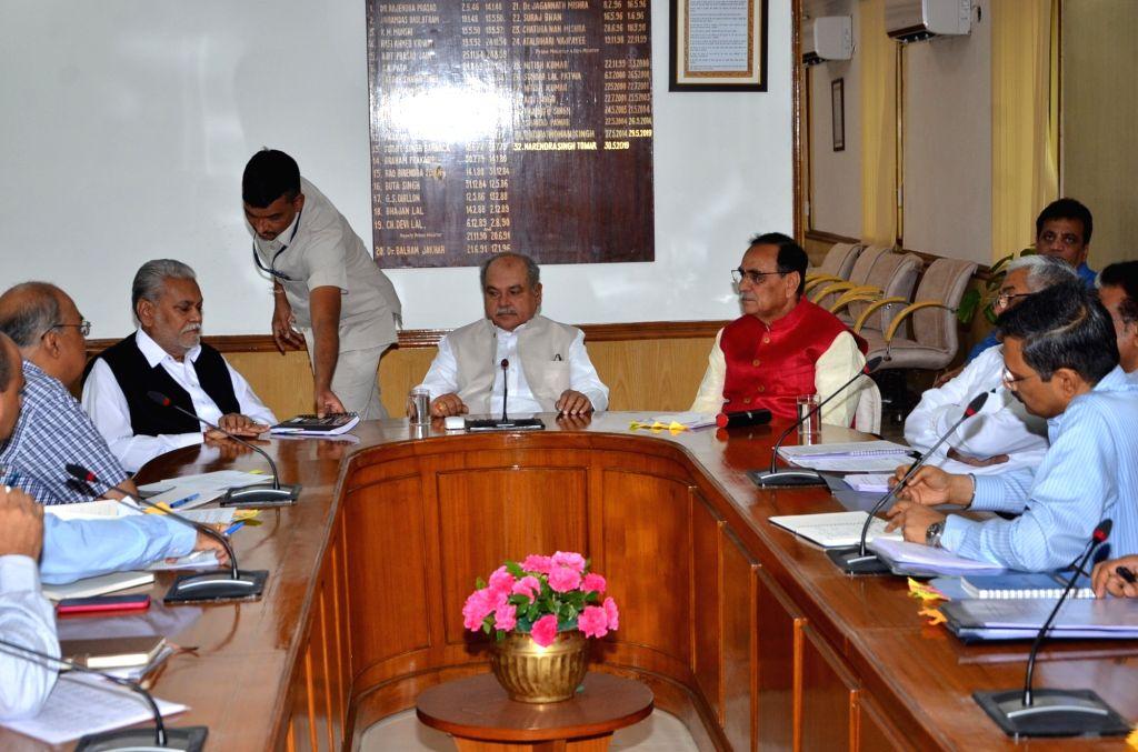 Gujarat Chief Minister Vijay Rupani meets Union Agriculture and Farmers Welfare Minister Narendra Singh Tomar and MoS Agriculture and Farmers Welfare Parshottam Rupala at Krishi Bhawan in ... - Vijay Rupani and Narendra Singh Tomar