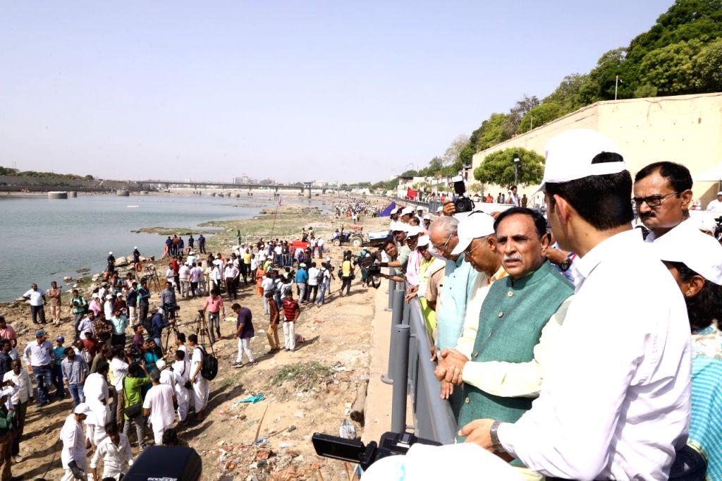 Gujarat Chief Minister Vijay Rupani oversees massive five-day Sabarmati river clean-up campaign initiated by Ahmedabad Municipal Corporation. (Photo: IANS) - Vijay Rupani