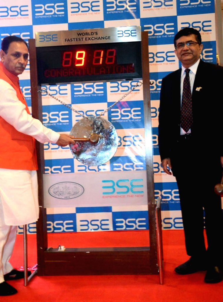 Gujarat Chief Minister Vijay Rupani rings the opening bell at Bombay Stock Exchange (BSE) in Mumbai on Nov 22, 2016. Also seen BSE CEO Ashish Kumar Chauhan. - Vijay Rupani and Ashish Kumar Chauhan