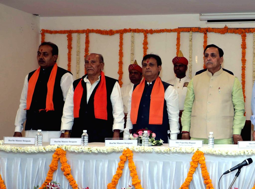 Gujarat chief minister Vijay Rupani with Jawahar Chavda, Yogesh Patel and Dharmendrasinh Jadeja who were inducted into as ministers in his government in Ahmaedabad, on March 9, 2019. - Vijay Rupani and Yogesh Patel