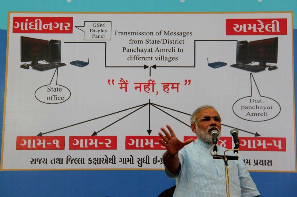 Gujarat CM Narendra Modi launches ???Gujarat Swarnim Gram E-Broadcast Project' in Amreli??? in 2011. - Narendra Modi