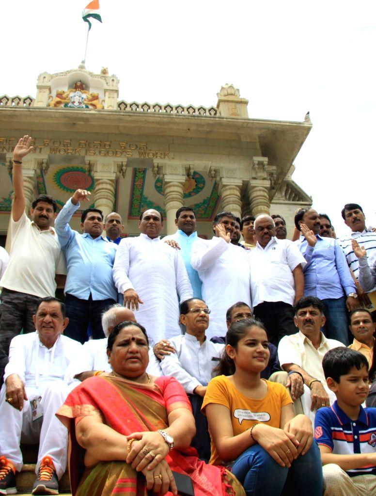 Gujarat Congress MLAs inside Council Hall at Vidhana Soudha to meet Karnataka Governor Vajubhai Rudabhai Vala in Bengaluru on Aug 5, 2017.