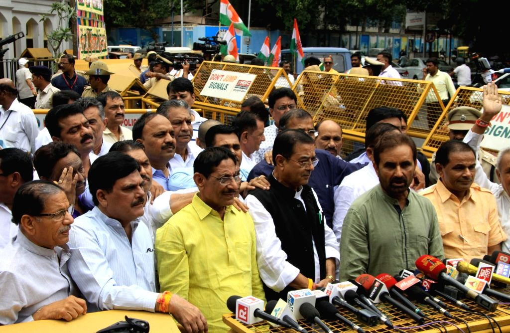 Gujarat Congress MLAs talk to press after meeting with Karnataka Governor Vajubhai Rudabhai Vala at Raj Bhavan in Bengaluru on Aug 5, 2017.