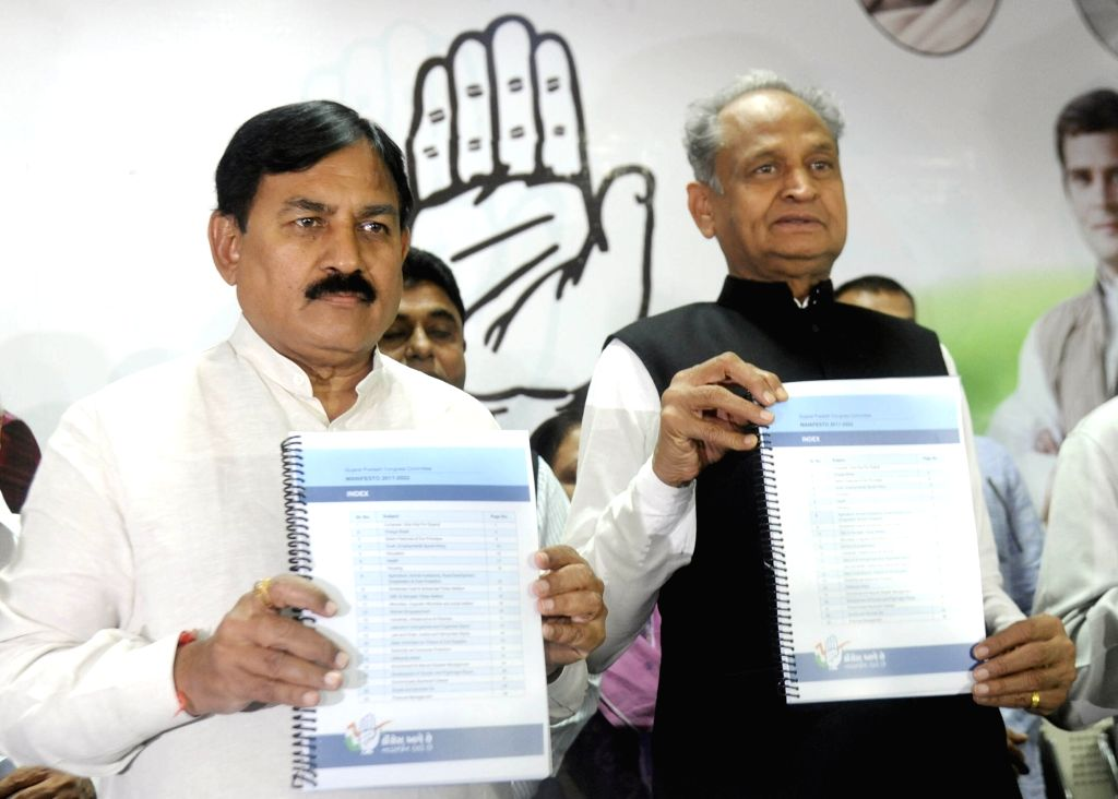 Gujarat Congress President Bharat Solanki (L) and Congress General Secretary Ashok Ghalot (R) during a programme organised to release party's manifesto ahead of Gujarat Assembly Polls in ...
