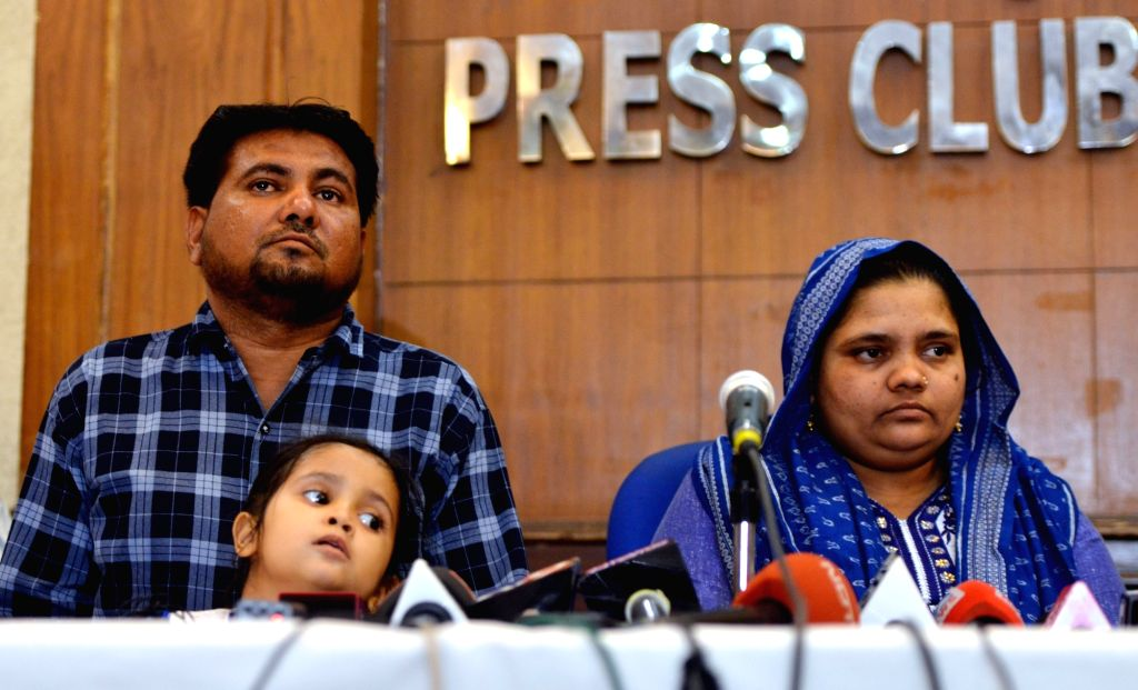 Gujarat gang-rape survivor Bilkis Yakub Rasool Bano with her husband and daughter, during a press conference in New Delhi, on April 24, 2019. Bano was gang-raped at the age of twenty-one ...