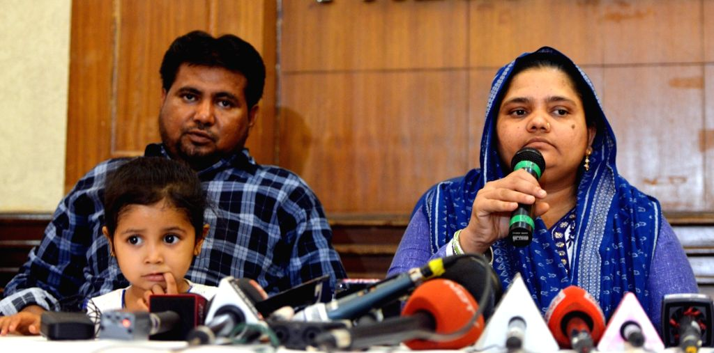 Gujarat gang-rape survivor Bilkis Yakub Rasool Bano accompanied by her husband and daughter, addresses a press conference in New Delhi, on April 24, 2019. Bano was gang-raped at the age of ...