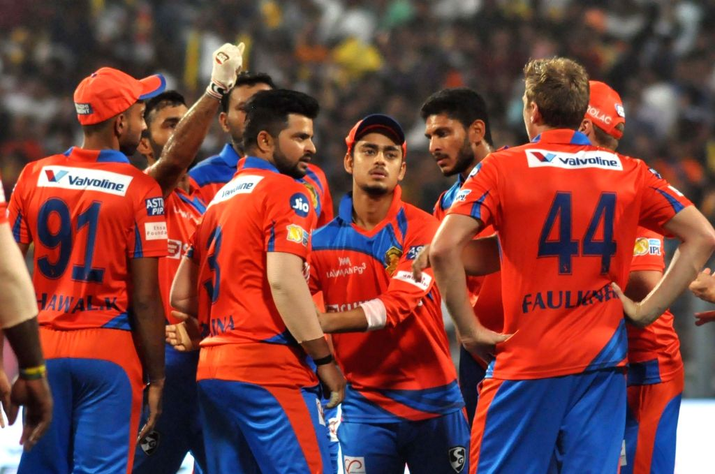 Gujarat Lions players celebrate fall of Sunil Narine's wicket during an IPL 2017 match between Kolkata Knight Riders and Gujarat Lions at Eden Gardens in Kolkata, on April 21, 2017.