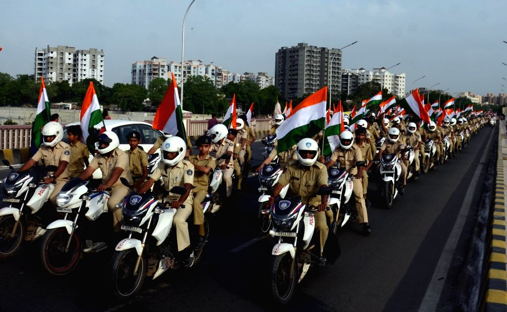 """Gujarat Policemen participate in """"Tiranga Yatra"""" on the eve of Independence day in Ahmedabad on Aug 14, 2016."""
