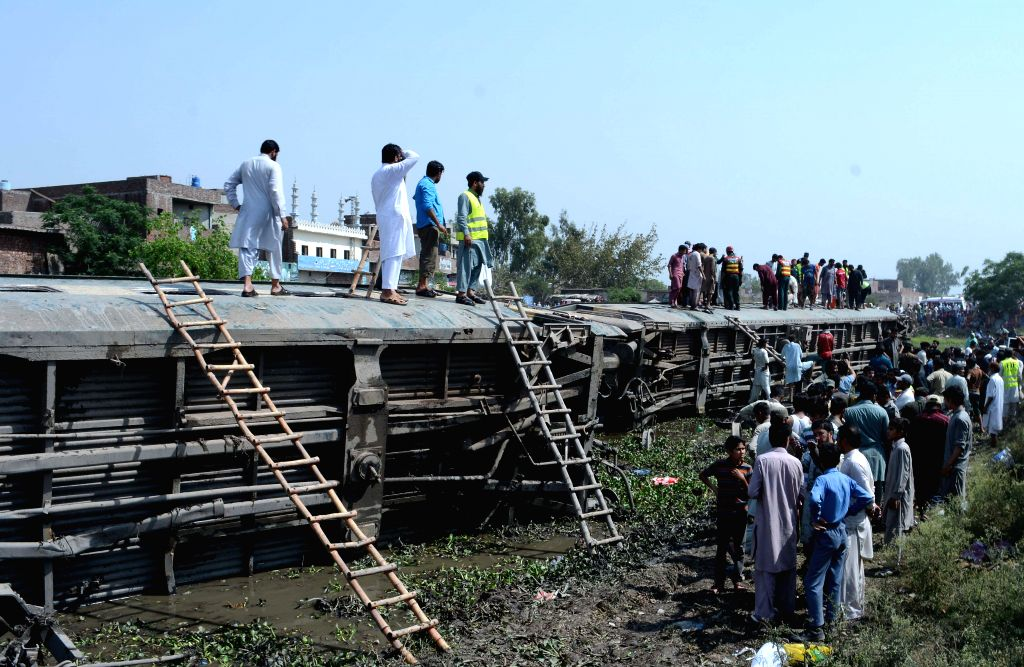 GUJRANWALA, April 18, 2017 - Locals gather at the train accident site in east Pakistan's Gujranwala, on April 18, 2017. At least 13 people were injured when five compartments of Quetta-bound Jaffar ...