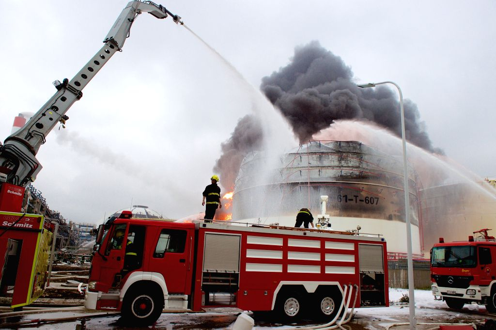 Firefighters try to extinguish fire at the site of a chemical plant blast in Zhangzhou, southeast China's Fujian Province, April 7, 2015. A xylene facility leaked oil ...