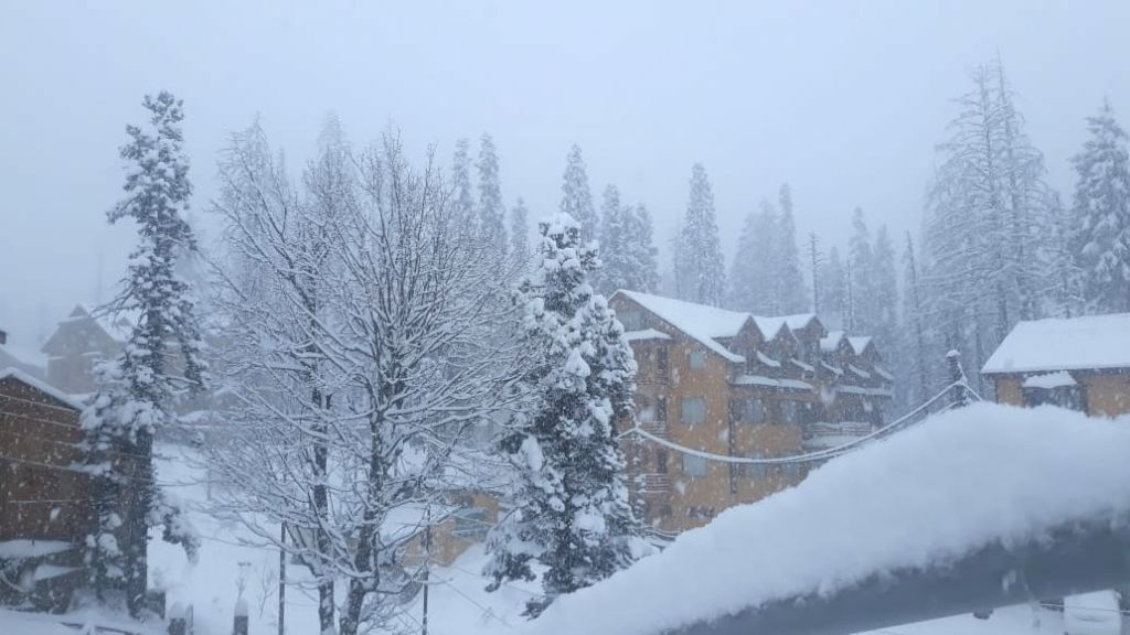 Gulmarg: A view of Jammu and Kashmir's Gulmarg during heavy snowfall on Dec 10, 2018. Rains lashed the plains of Jammu and Kashmir, while fresh snowfall occurred in the higher reaches of the state on Monday. Snowfall occurred in Minimarg in Kargil, G