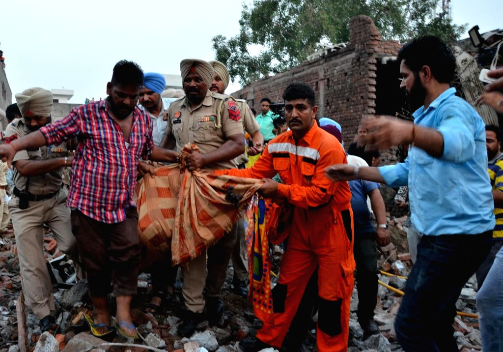 Gurdaspur: A body being retrieved from the site of a blast at an unauthorized firecracker factory in a residential in Batala town of Punjab's Gurdaspur district on Sep 4, 2019. At least 19 people were killed and more than 25 injured in the blast. (Ph