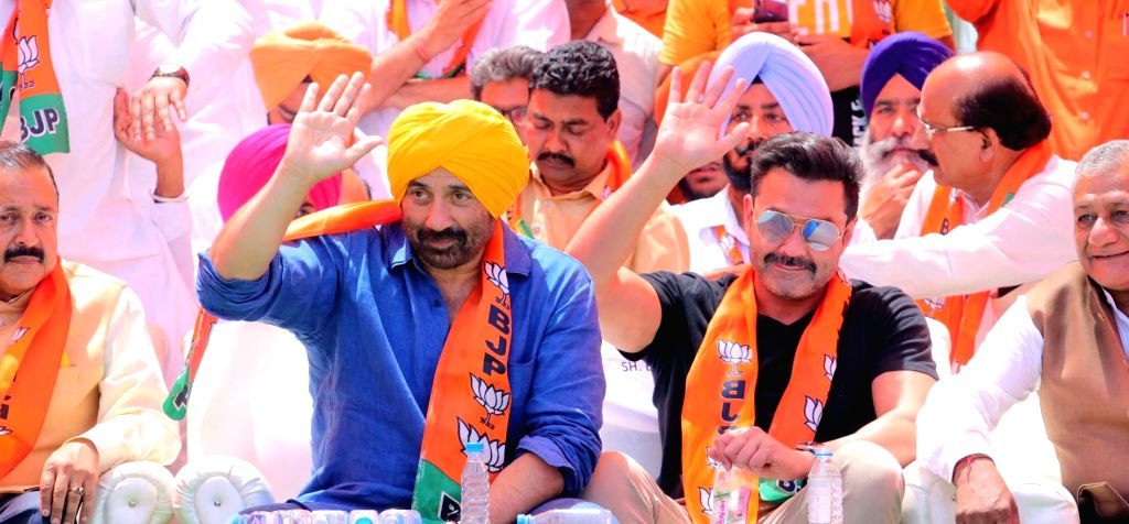 Gurdaspur: BJP candidate for Gurdaspur Lok Sabha seat Sunny Deol with his brother Bobby Deol during a party rally in Gurdaspur, Punjab on April 29, 2019. (Photo: IANS)