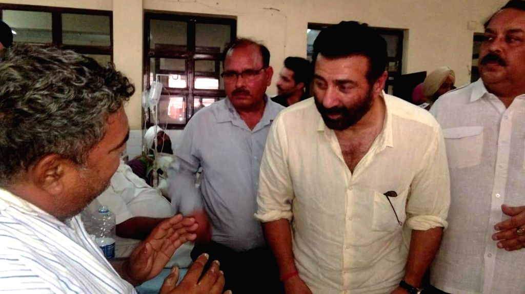 Gurdaspur BJP MP Sunny Deol meets the victims of factory blast receiving treatment at a Batala hospital, on Sep 5, 2019. At least 21 people were killed and 26 injured in an explosion ...
