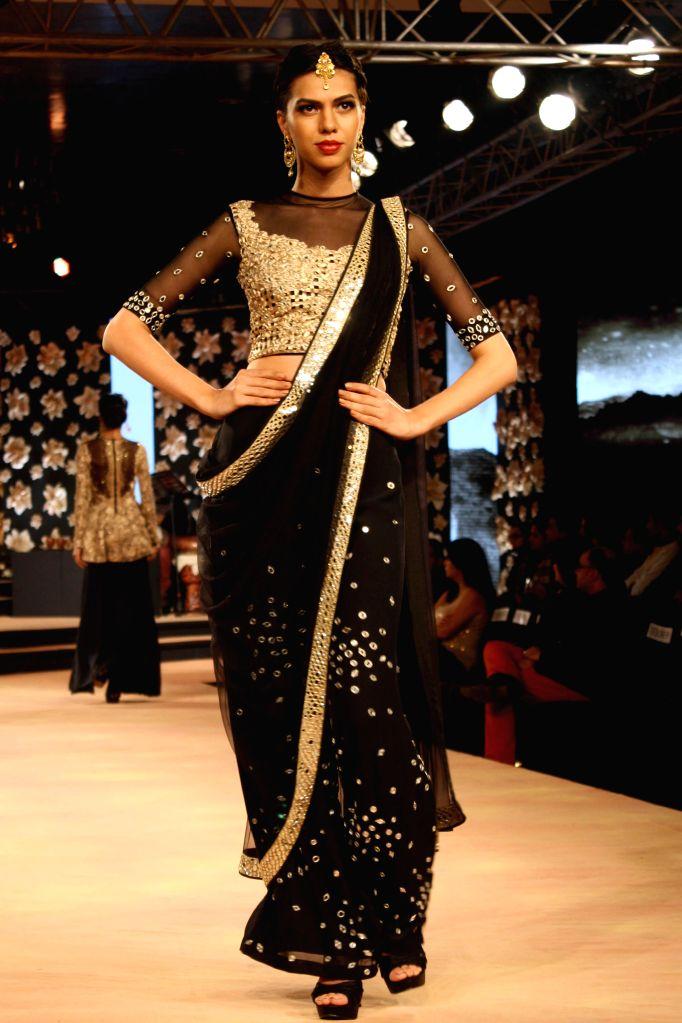 A model showcases fashion designer Neeta Lulla's creations at the Blenders Pride Fashion Tour 2014, in Gurgaon, on Nov 23, 2014.