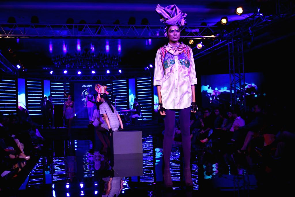 A model showcases Little Shilpa`s creations at the Blenders Pride Fashion Tour 2014, in Gurgaon, on Nov 23, 2014.
