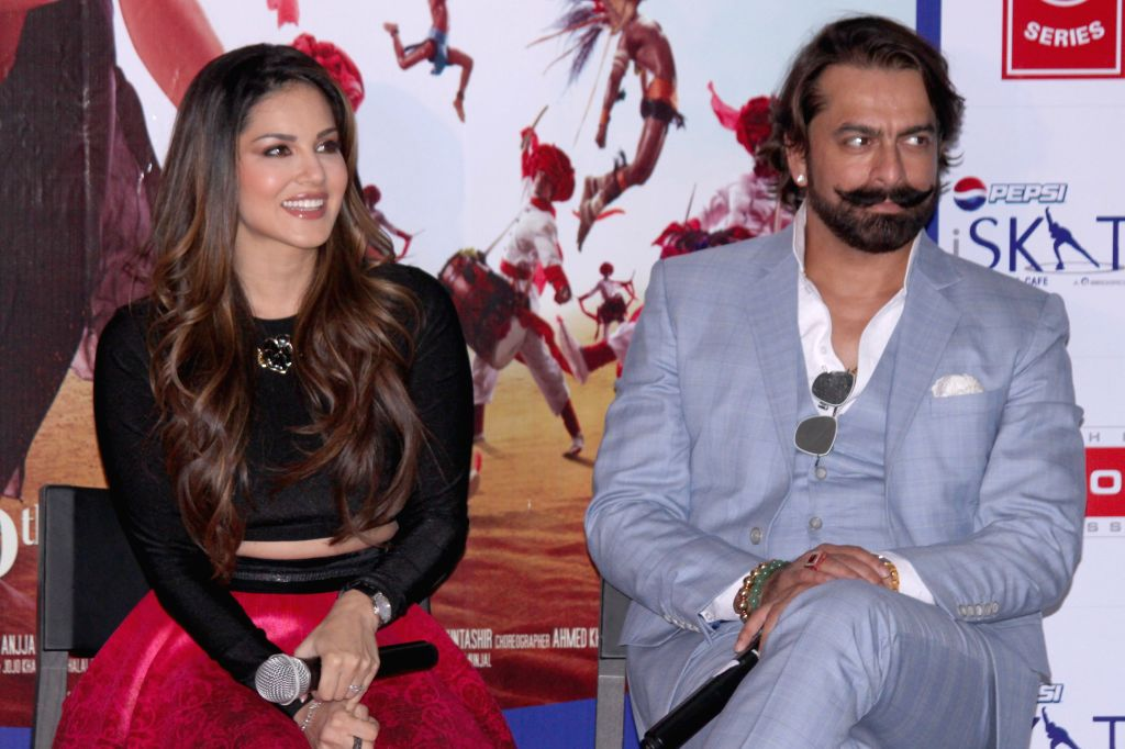 Actors Sunny Leone and Jas Arora during the promotion of film `Ek Paheli Leela`, in Gurgaon on April 7,2015.