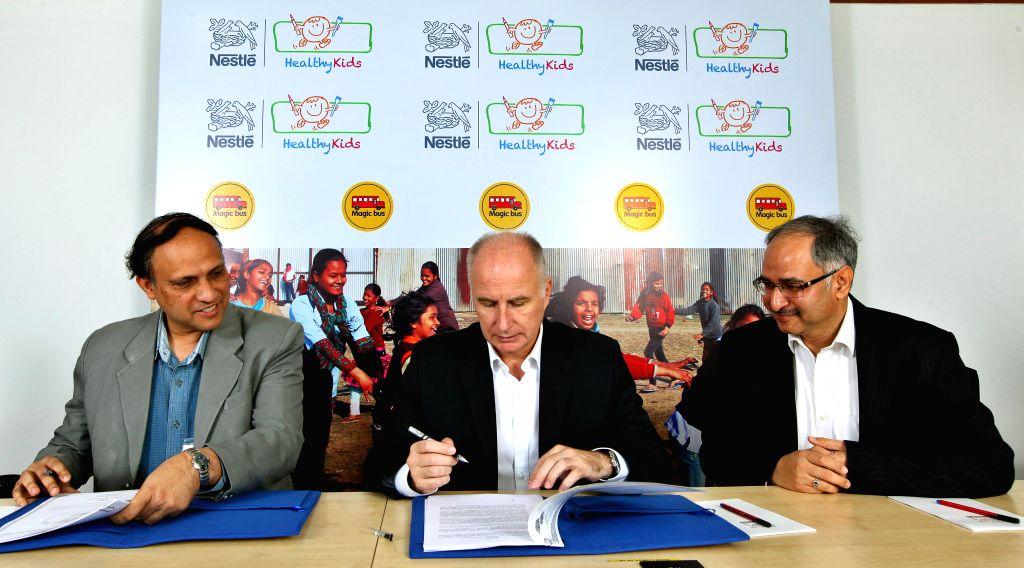 (L to R) CEO of Magic Bus Pratik Kumar, Managing Director Nestle India  Etienne Benet, Sr.V.P. Nestle India Sanjay Khajuria during a prgramme where Nestle India inks an agreement with the ... - Bus Pratik Kumar