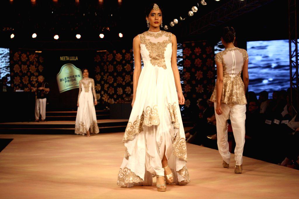 Model showcase fashion designer Neeta Lulla's creations at the Blenders Pride Fashion Tour 2014, in Gurgaon, on Nov 23, 2014.