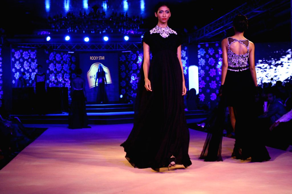 Models showcase creations of fashion designer Rocky Star at the Blenders Pride Fashion Tour 2014, in Gurgaon, on Nov 23, 2014.