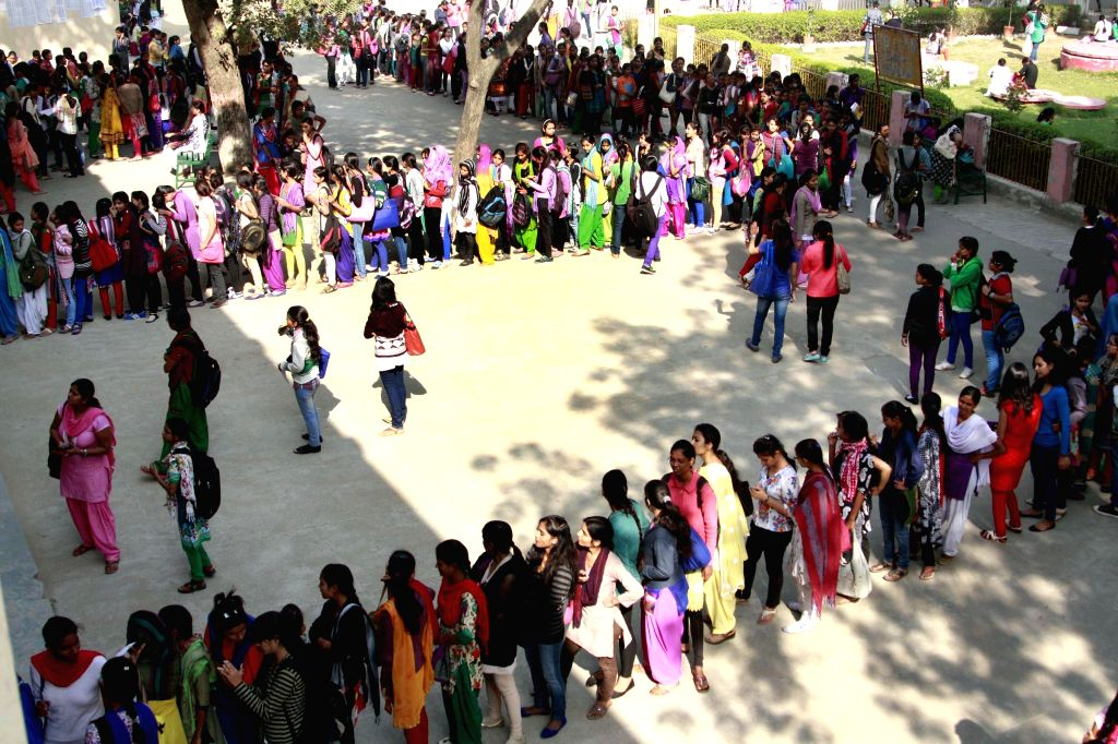 Students queue-up at a government college to collect their roll numbers in Gurgaon on Nov 18, 2014.