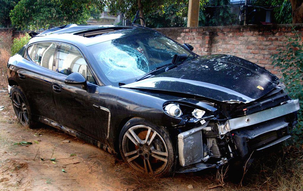 The mangled remains of  a luxury car that killed three labourers near Shankar Chowk on Delhi-Gurgaon expressway in Gurgaon, Haryana on Dec 15, 2014.