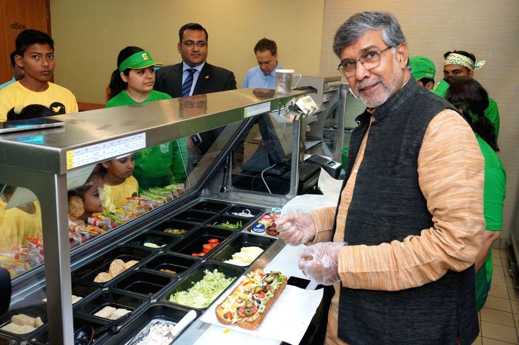 :Gurugram: Child Rights activist and Nobel laureate Kailash Satyarthi creating new sandwich recipe to kick off the World Sandwich Day 2018 festivities at Subway in Gurugram on Oct 24, 2018. World ...