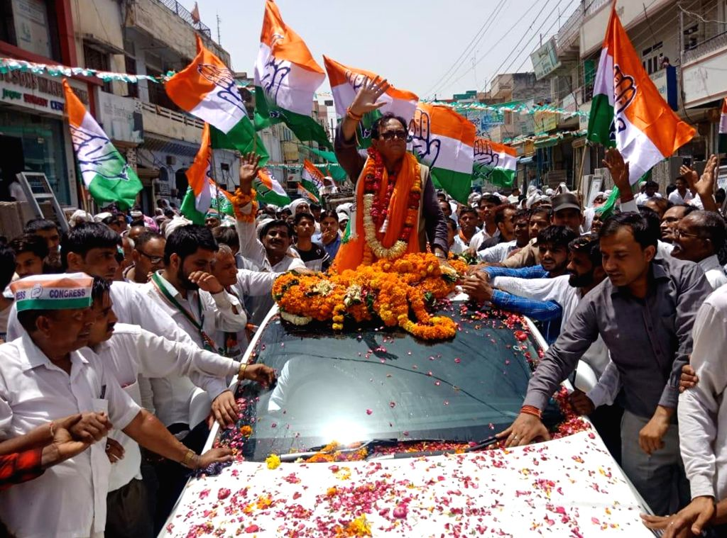 Gurugram: Congress' Lok Sabha candidate from Gurugram, Captain Ajay Singh Yadav during a roadshow ahead of the 2019 Lok Sabha elections, in Gurugram on May 10, 2019. (Photo: IANS) - Ajay Singh Yadav