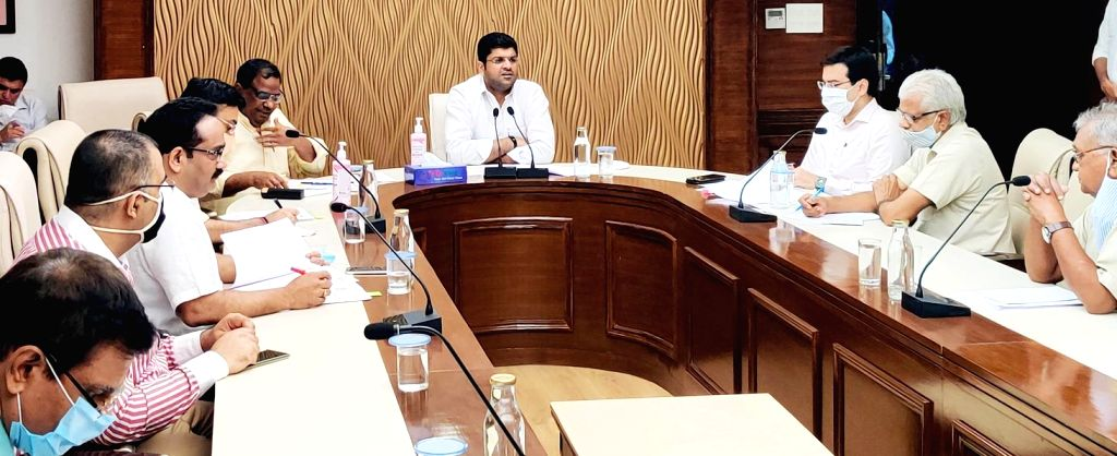 Gurugram: Haryana Deputy Chief Minister Dushyant Chautala presides over the 2nd meeting of State Advisory Contract Labour Board in Gurugram on July 30, 2020. (Photo: IANS) - Dushyant Chautala