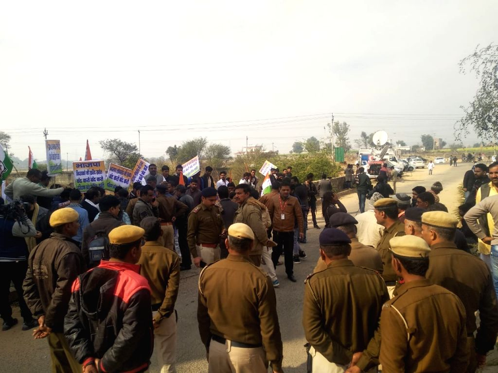 Gurugram: Police deployed outside the ITC Grand Bharat resort in Gurugram, Haryana amid Congress workers protest outside the hotel, where over 100 BJP MLAs from Karnataka are housed to guard against their poaching on Jan 16, 2019. (Photo: IANS)