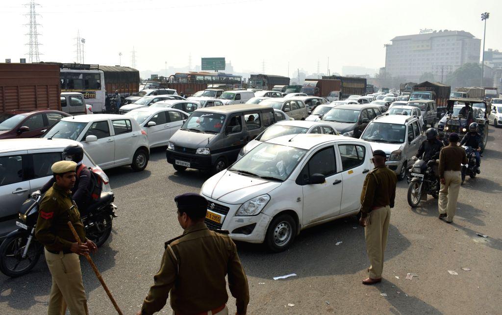 Gurugram: Security checks cause heavy traffic jam after Delhi-NCR put on high alert ahead of the farmers 'Parliament gherao' rally in Gurugram on Feb 23, 2018. (Photo: IANS)