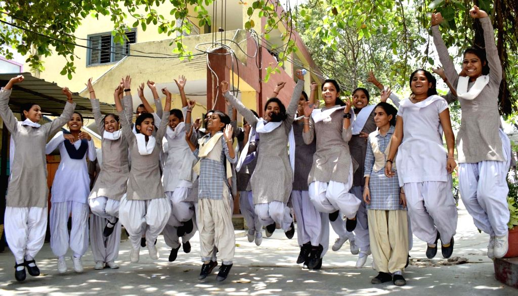 :Gurugram: Students celebrate after the Board of School Education Haryana (BSEH) declared class 10th examination results, in Gurugram on May 21, 2018. (Photo: IANS).