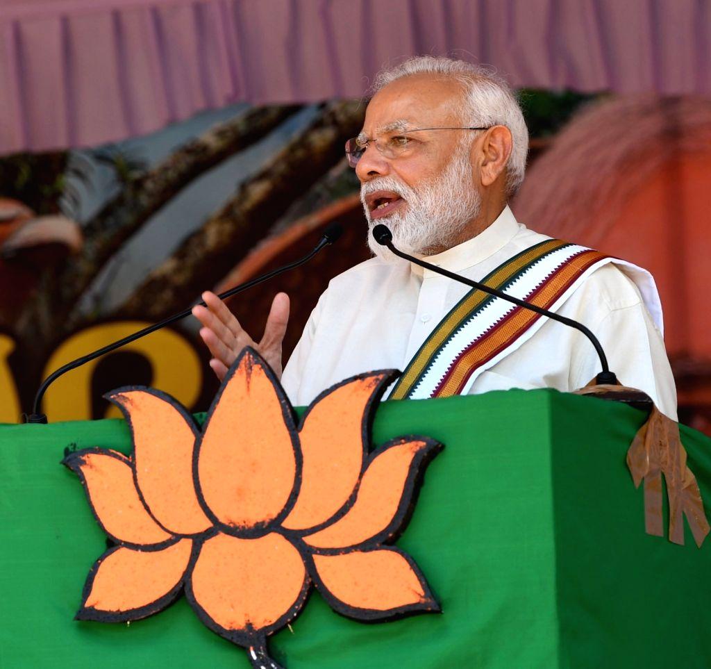 Guruvayoor: Prime Minister Narendra Modi addresses a public meeting in Guruvayoor, Kerala on June 8, 2019. (Photo: IANS) - Narendra Modi
