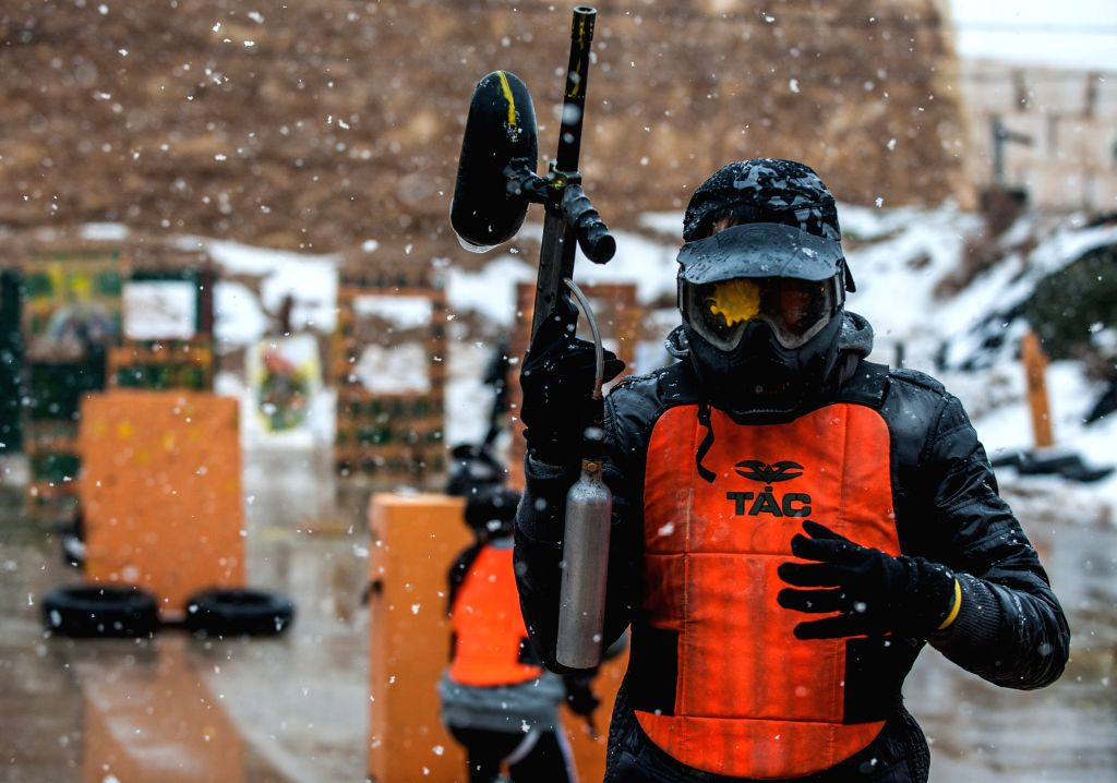 """A student leaves a paintball shooting after his goggle was shot during a military and counter-terror drill at """"Caliber 3"""" Israeli Counter Terror and ..."""