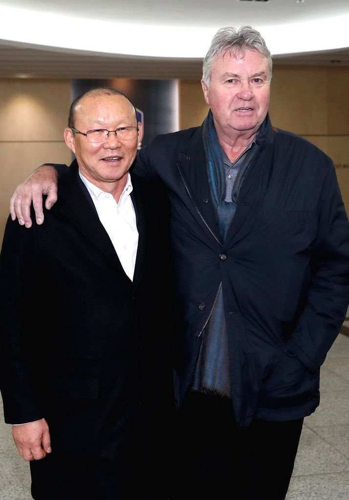 Guus Hiddink (R), former head coach of the South Korean men's national football team, poses with Park Hang-seo, head coach of the Vietnamese national football squad, in Seoul on Feb. 13, 2018, ...