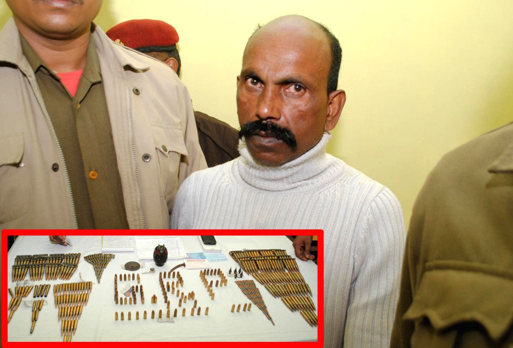 (A Combo Picture) Police personnel present a Havildar of Meghalaya Police who was arrested with a huge cache of ammunition from Guwahati Railway Station on Jan 12, 2015.