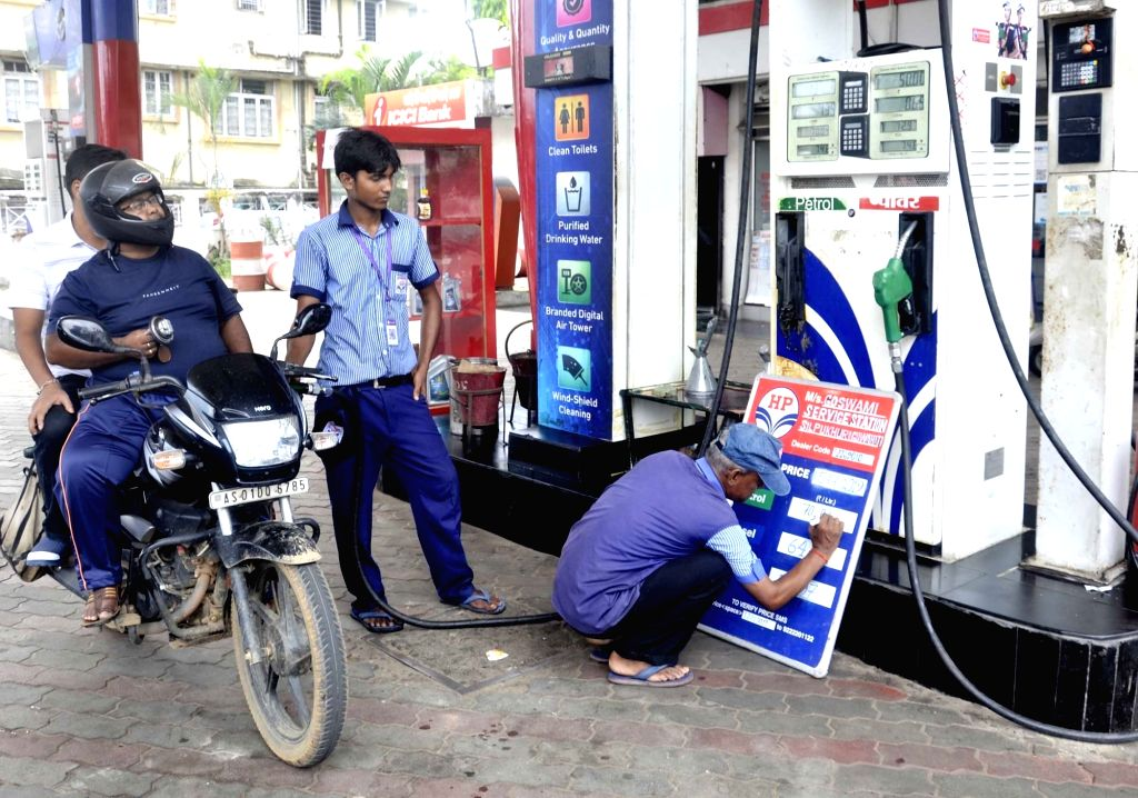 Guwahati: A worker writes the revised rates of petrol and diesel at a petrol pump in Guwahati, on July 5, 2019.  Petrol and diesel prices are set to increase from Friday midnight as Union Finance Minister Nirmala Sitharaman who presented the Union Bu - Nirmala Sitharaman