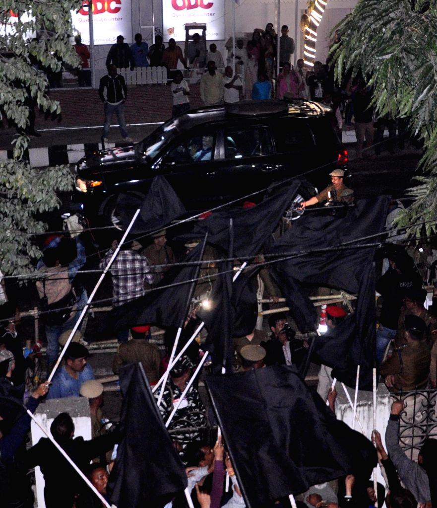 Guwahati: AASU activists show black flags to Prime Minister Narendra Modi in Guwahati on Feb 8, 2019. (Photo: IANS) - Narendra Modi