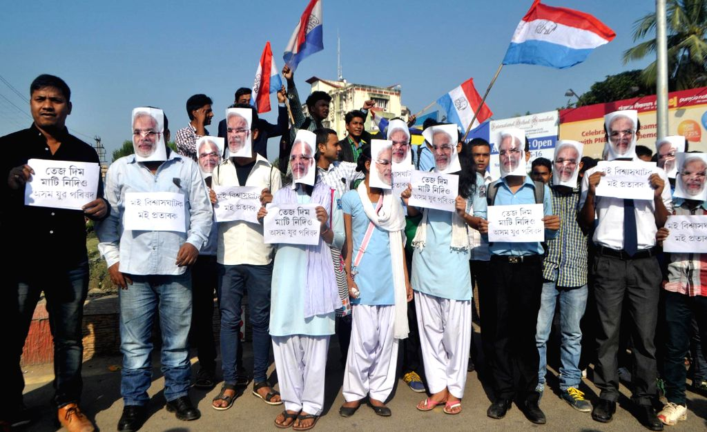 Activists Asom Yuva Parishad (AYP) wearing masks of Prime Minister Narendra Modi demonstrate against Indo-Bangladesh land swap deal in Guwahati on Dec 4, 2014. - Narendra Modi