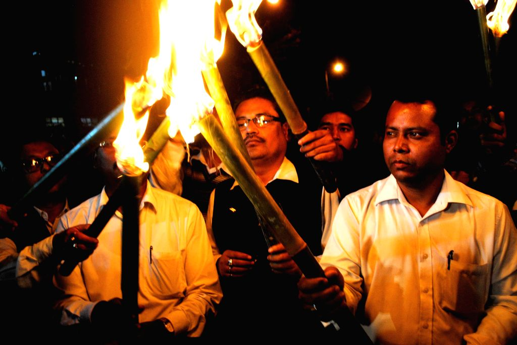 Activists of All Assam Students' Union (AASU) participate in a torch light procession against Indo-Bangladesh land swap deal in Guwahati on Dec 4, 2014.